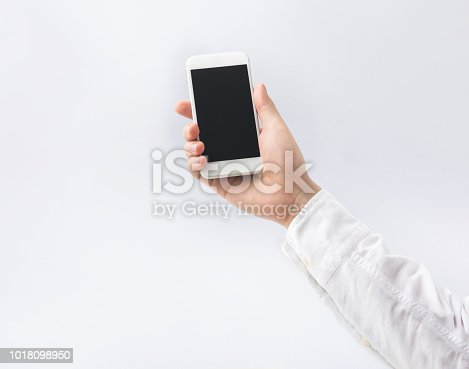 Male hand holding smartphone,mobile on white background.business and technology concepts ideas