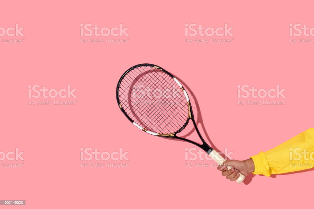 male hand holding tennis racket on pink background - Royalty-free Activity Stock Photo