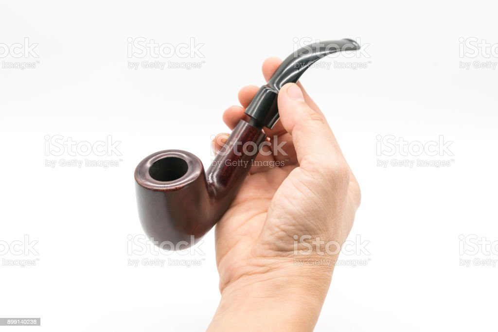 Male hand holding vintage dark brown pipe isolated on white background stock photo