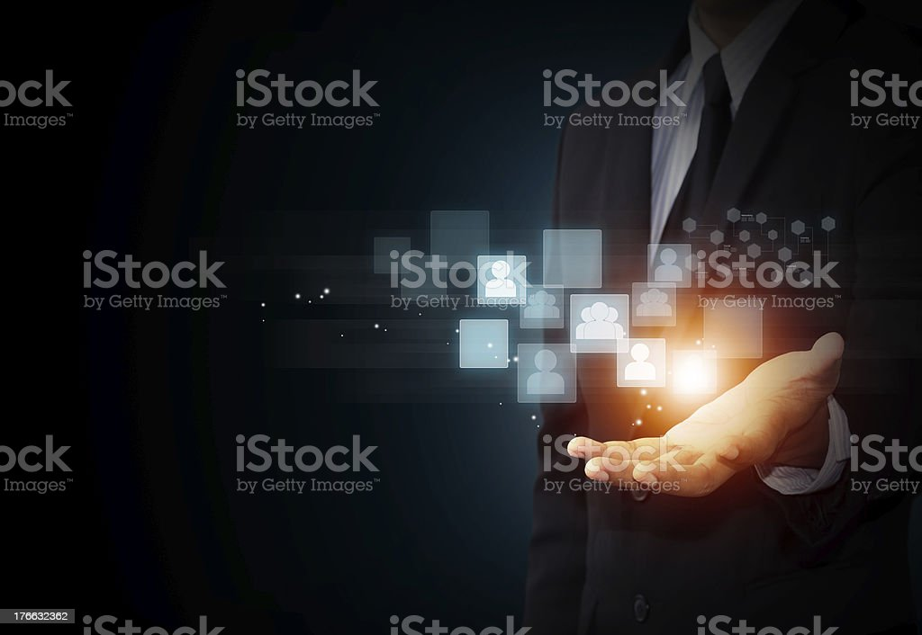 Male hand holding virtual icon of social media stock photo