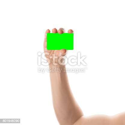 844190384 istock photo Male hand holds a credit card or business card. Isolated with chroma key and all isolated on white 801948290