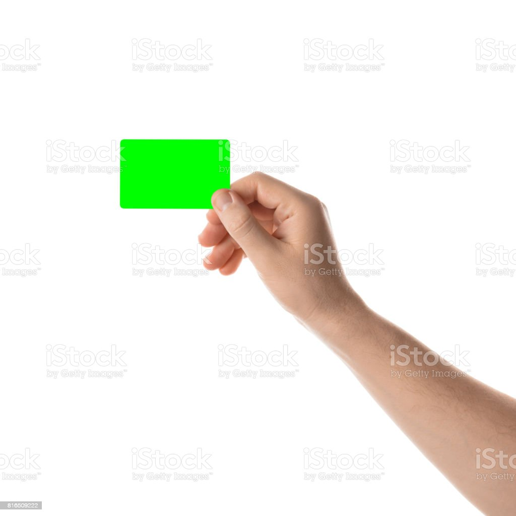 Male hand holds a credit card or business card. Isolated with chroma key stock photo