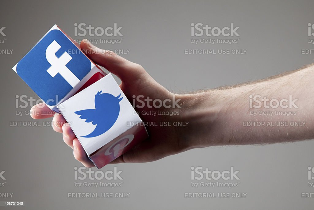 Male hand holds a social network of blocks royalty-free stock photo