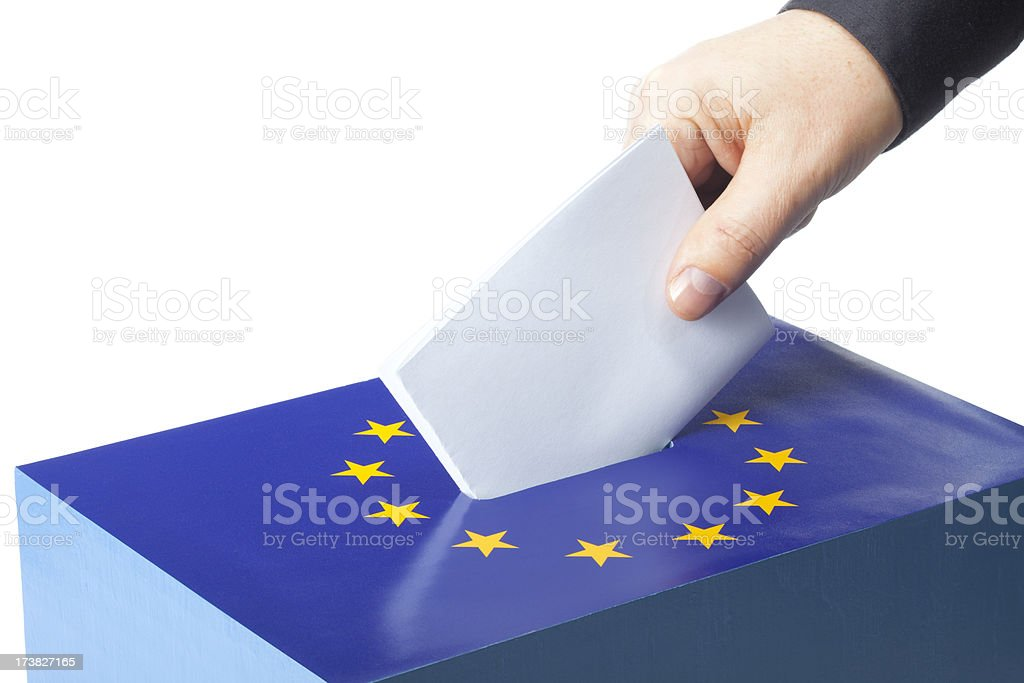 Male hand inserting ballot to EU ballot box stock photo