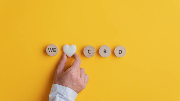 Male hand making a We love CBD sign stock photo