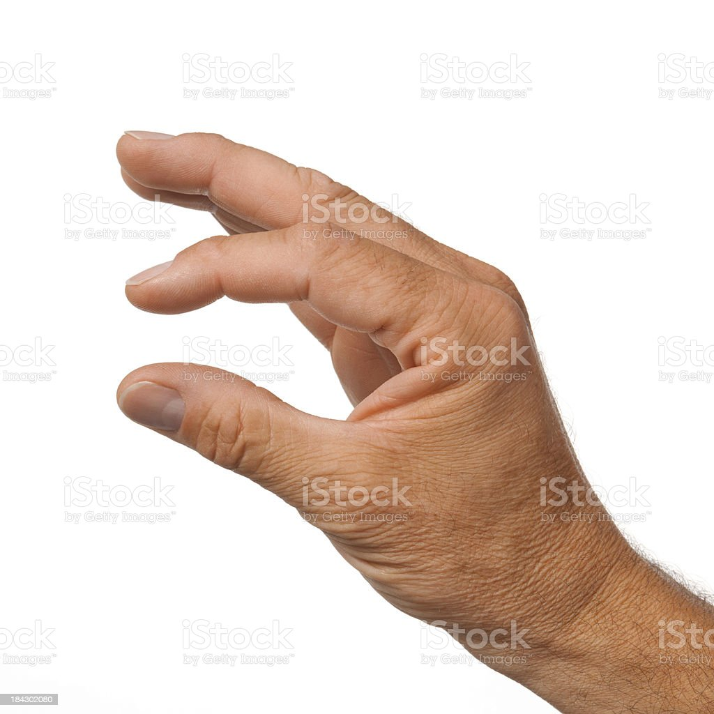 Male hand making the gesture of a little bit stock photo