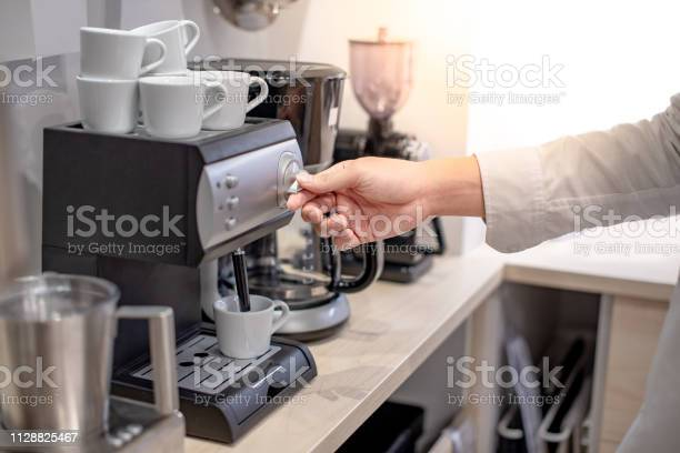 Male hand of barista twisting button on coffee machine in the cafe or picture id1128825467?b=1&k=6&m=1128825467&s=612x612&h=ad1zlbcfrqzqrwqh 8g cqjxctqqradgrt  e6brjb0=