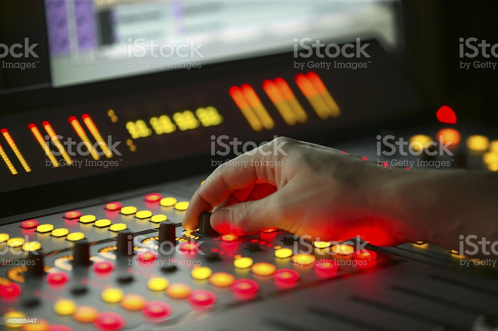 Male hand on control Film Mixing console stock photo