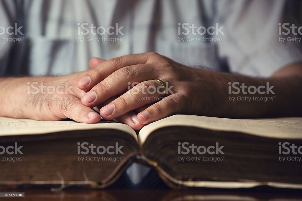 Male Hand On Open Bible stock photo