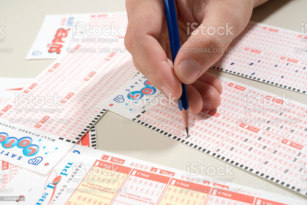 Male Hand Playing Turkish Lottery Stock Photo & More