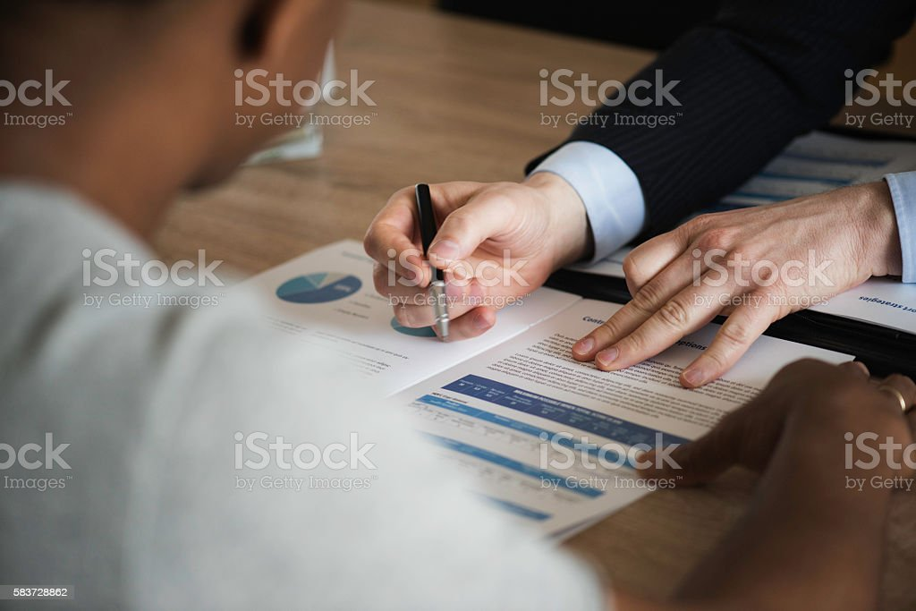 Male hand pointing at business document stock photo