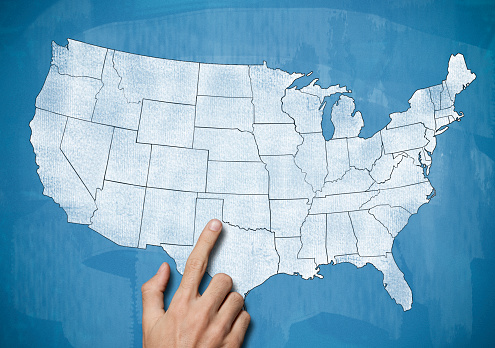 istock Male hand pointing on USA map / Blue board concept (Click for more) 920929032