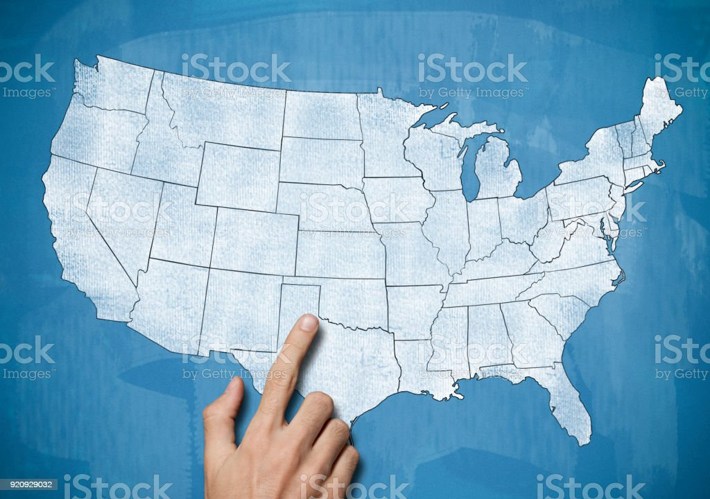 Male hand pointing on USA map / Blue board concept (Click for more) stock photo