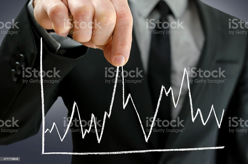 Male hand pulling line chart upwards stock photo