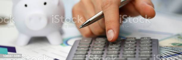 Male hand push key silver calculator is lying picture id1085613390?b=1&k=6&m=1085613390&s=612x612&h=fh8thkhv0c7ylxww8v7uhpn2uizr2az9ddecis6djgu=