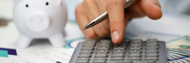 Male hand push key silver calculator is lying Male hand push key silver calculator is lying on desk cash dollar plots in home office setting. Calculation of family expenses social income population freelance irs situation growth research concept allowance stock pictures, royalty-free photos & images