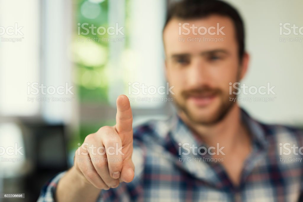 Male hand pushing a digital screen at modern office stock photo