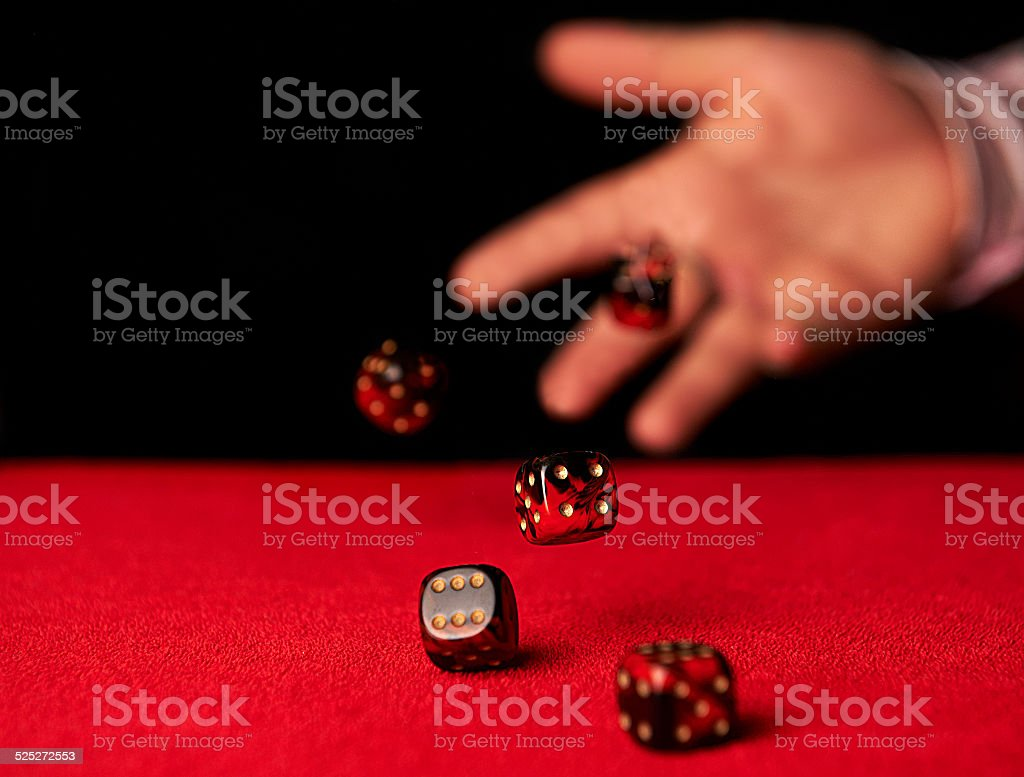 Male hand rolling dice stock photo