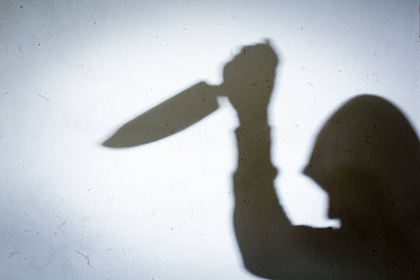 Male Hand Shadow with Kitchen Knife, stock photo