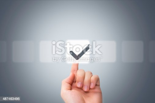 istock Male Hand Touching Button and Ticking Check Box 487463495