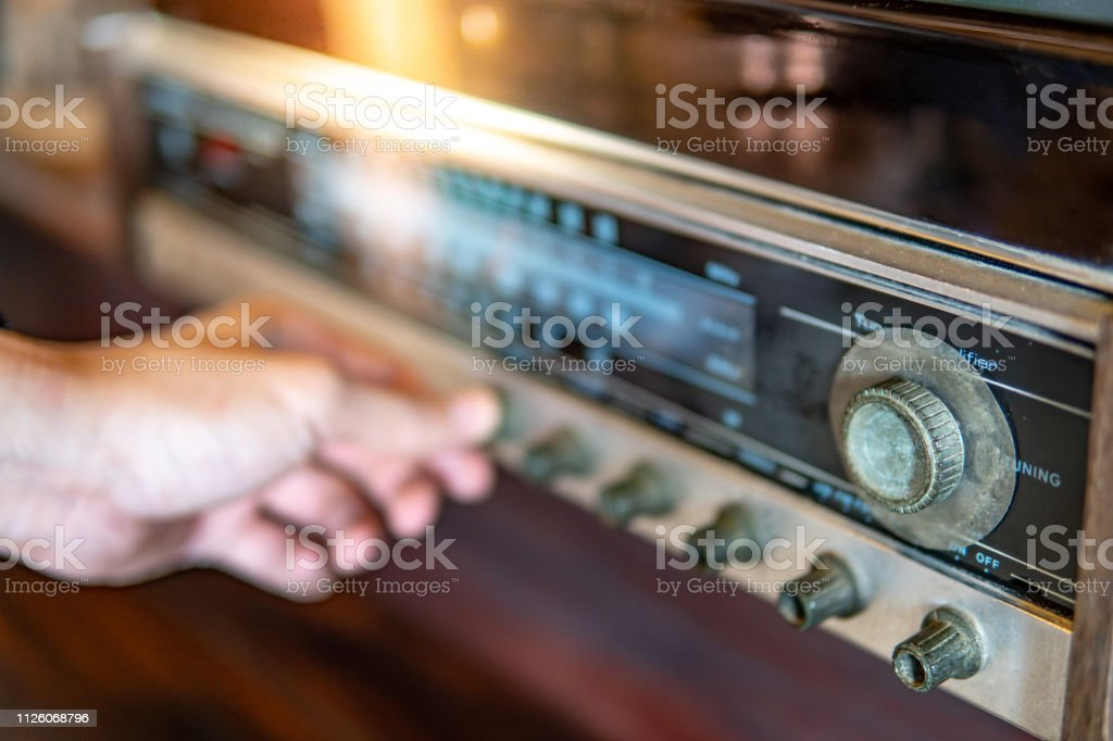 Male Hand Turning Retro Radio Button Listen To Music Or News