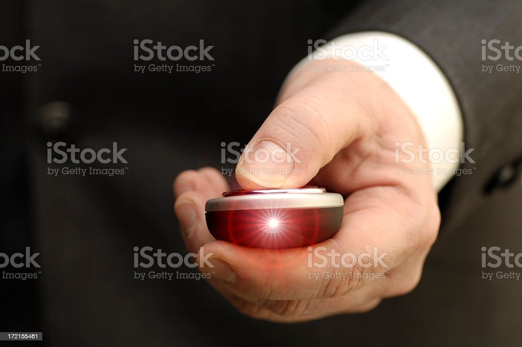 Male hand using a shining laser pointer stock photo