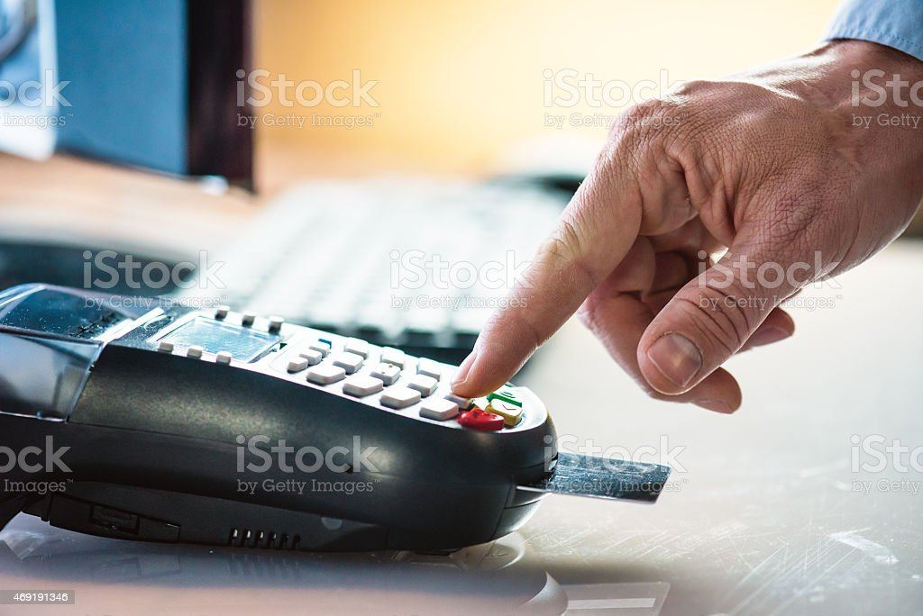 Male hand using smart card reader stock photo