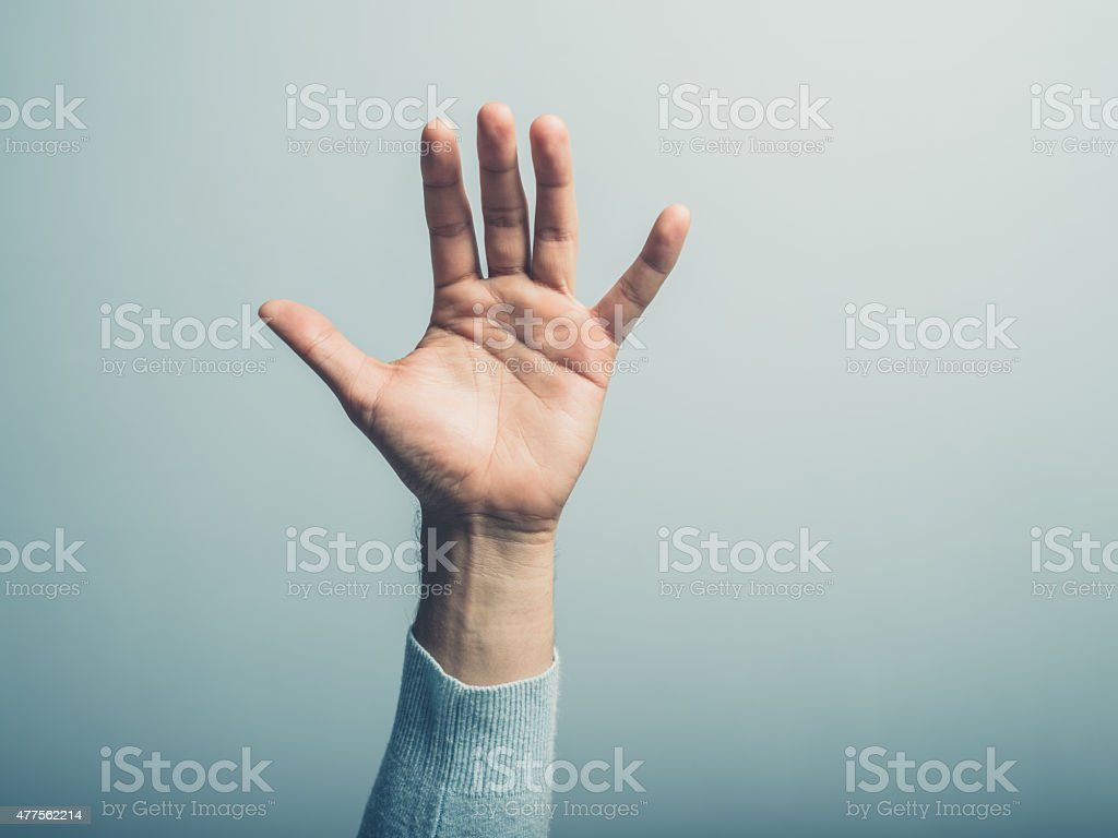 Male hand waving stock photo