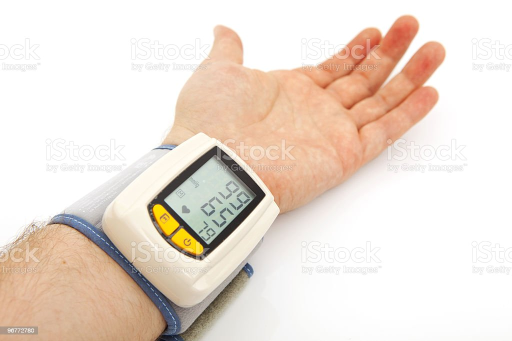male hand with automatic blood pressure monitor stock photo