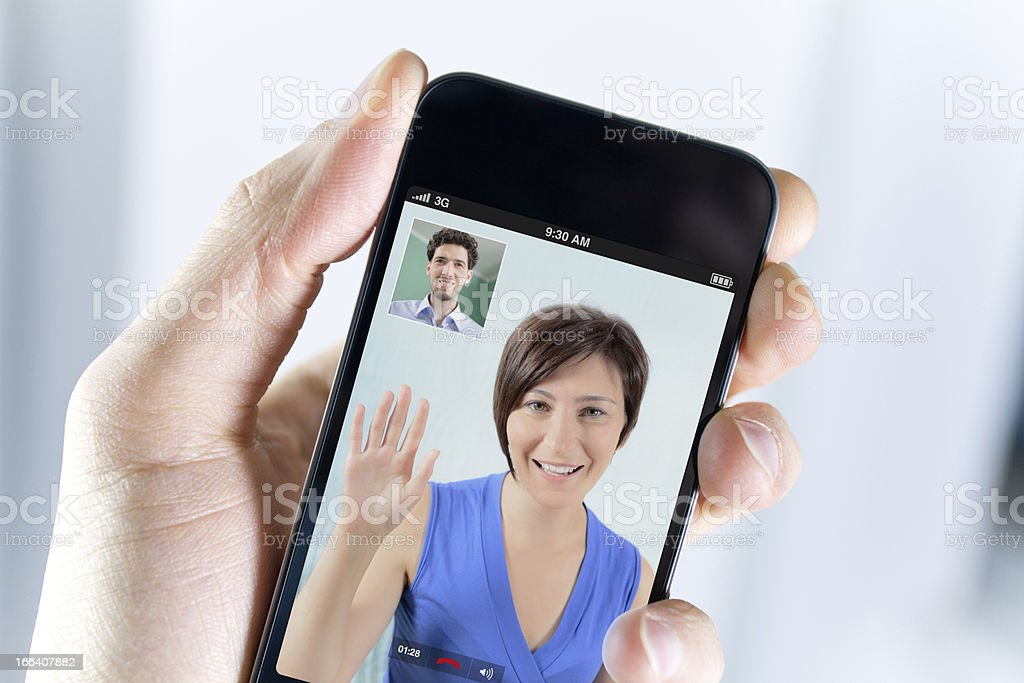Male hand with mobile phone during video call stock photo