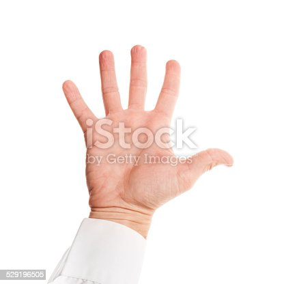 182925103 istock photo Male hand with open palm in shirt isolated on white 529196505