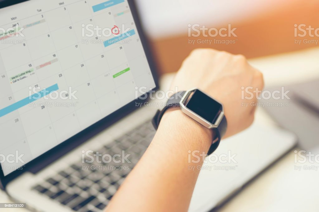 Male hand with smart watch on wrist. Planning agenda and schedule using calendar event planner. Calender planner, relax time remind concept. stock photo