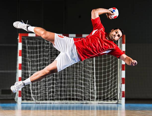 male handball player in action. - handboll bildbanksfoton och bilder
