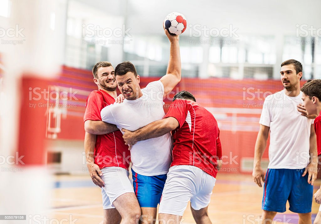 Male handball players in action. stock photo