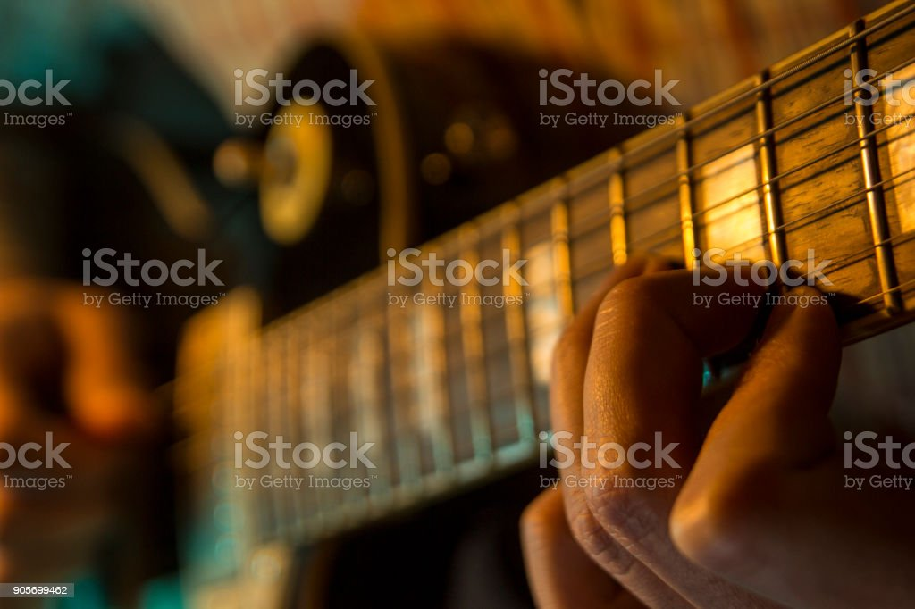 Male hands are playing electric guitar stock photo