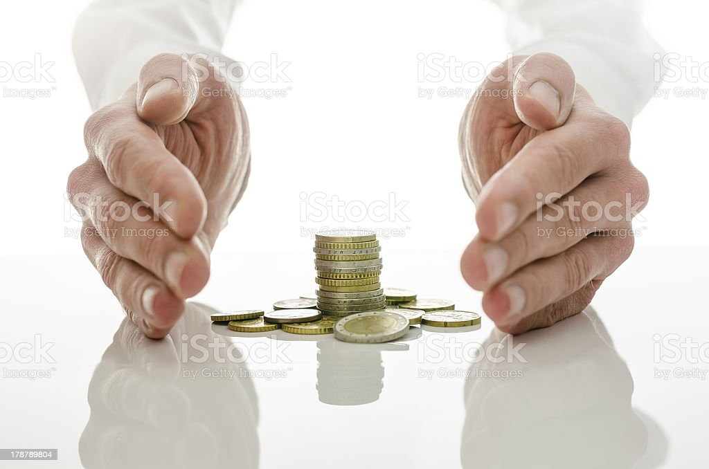 Male hands around Euro coins royalty-free stock photo
