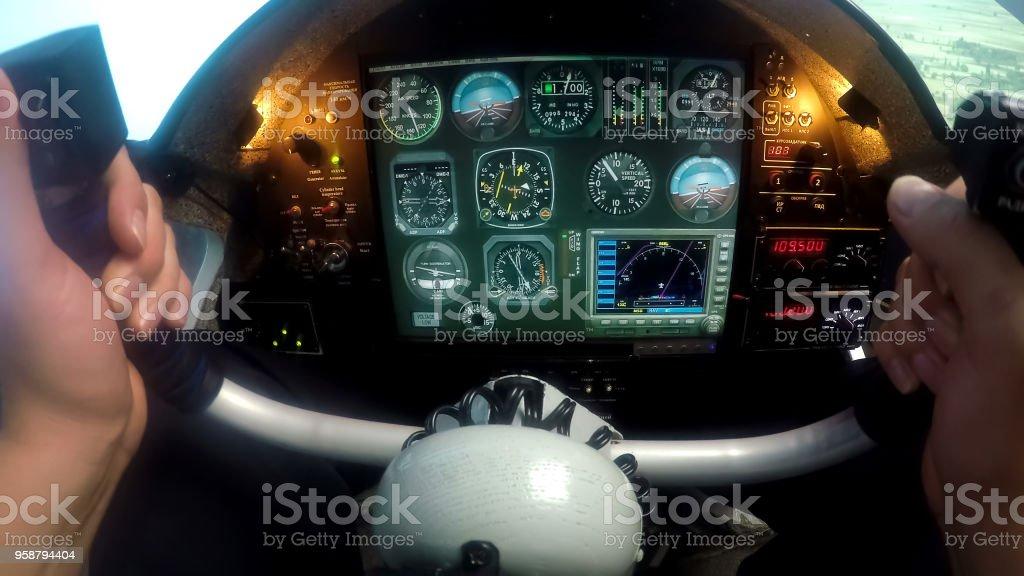 Male hands controlling flight simulator, beginner pilot practicing at school stock photo