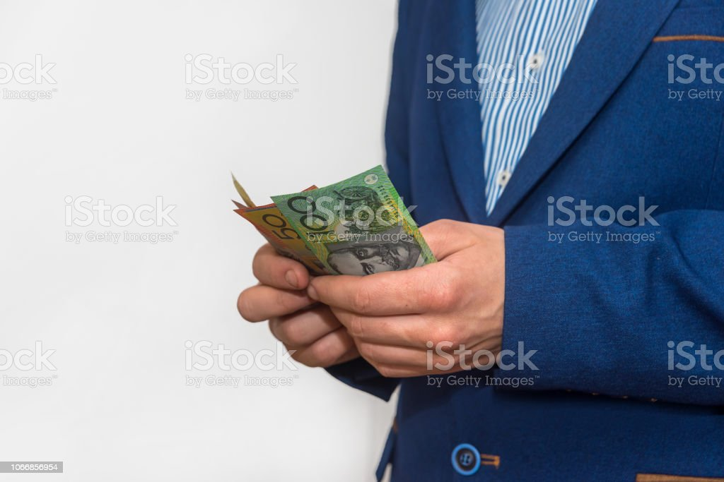 Male hands counting australian dollar banknotes, macro stock photo