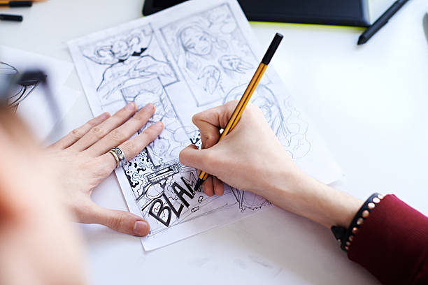 Male hands drawing the comics stock photo
