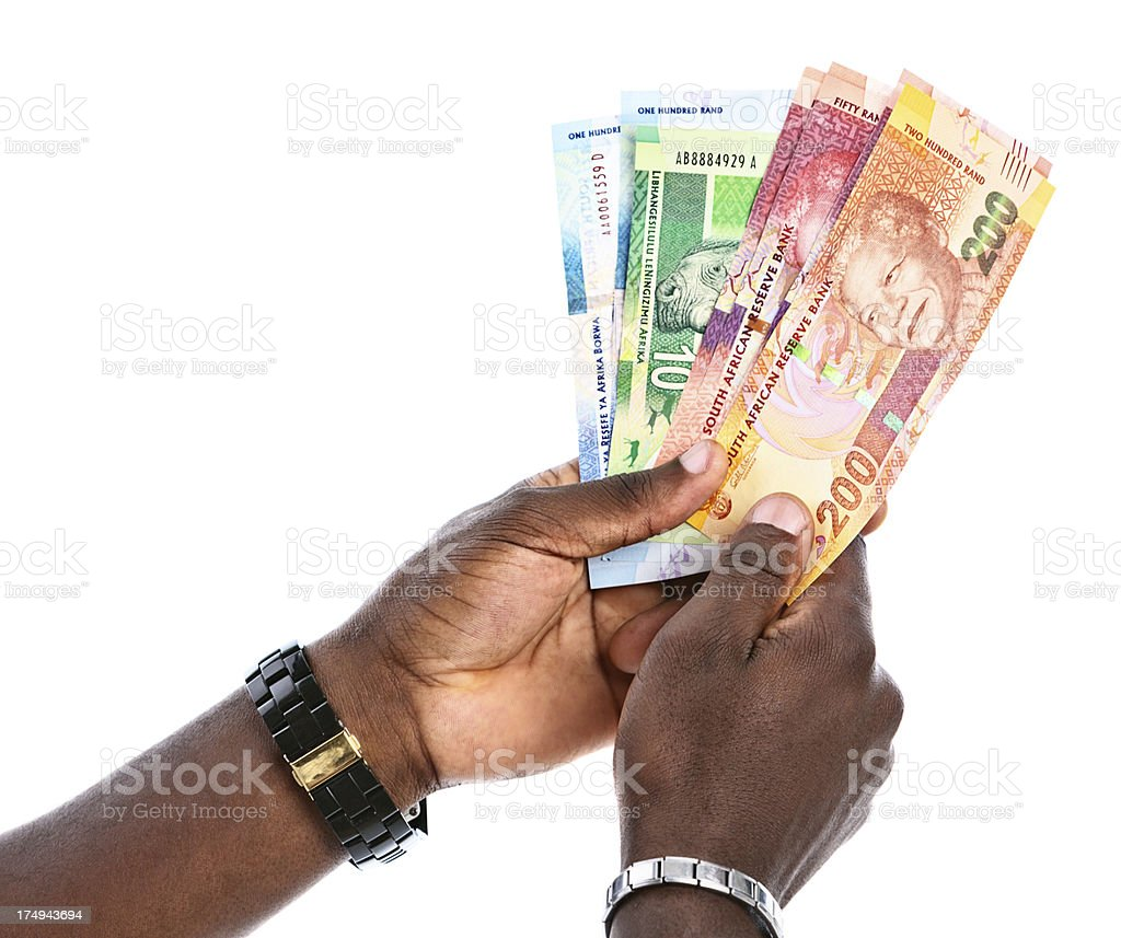 Male hands hold varied South African banknotes featuring Nelson Mandela stock photo