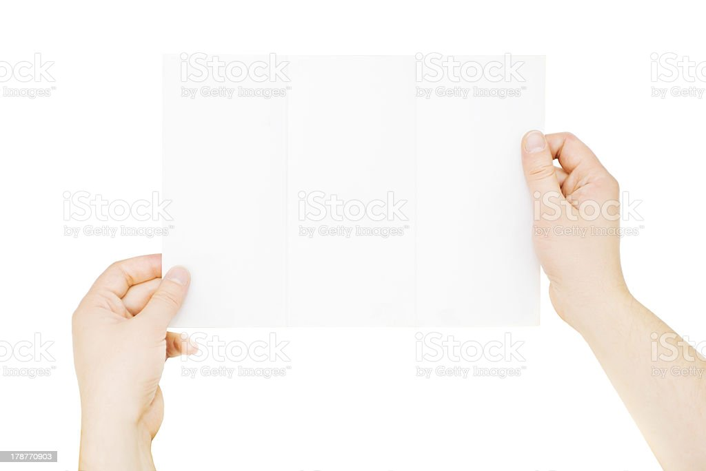Male hands holding blank paper, isolated on white stock photo