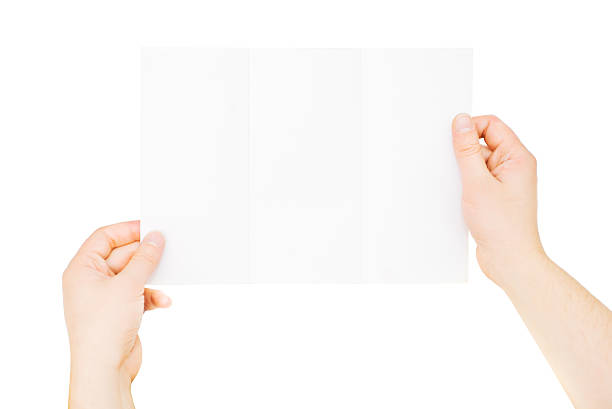 Male hands holding blank paper, isolated on white