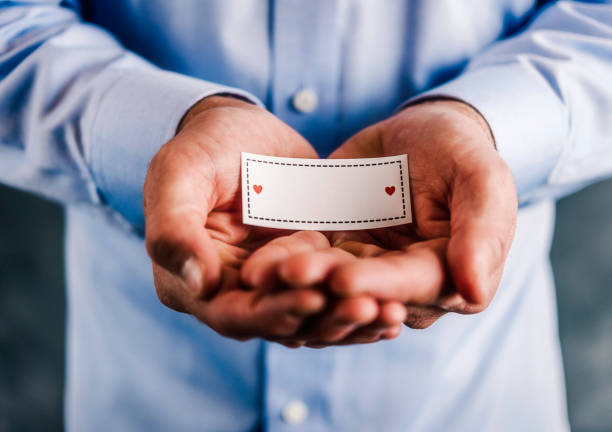 Royalty free heart shaped business cards pictures images and stock male hands holding blank sign for message stock photo colourmoves