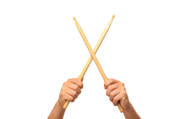 Male hands holding drum sticks Male hands holding drum sticks.isolated backgrund drummer stock pictures, royalty-free photos & images