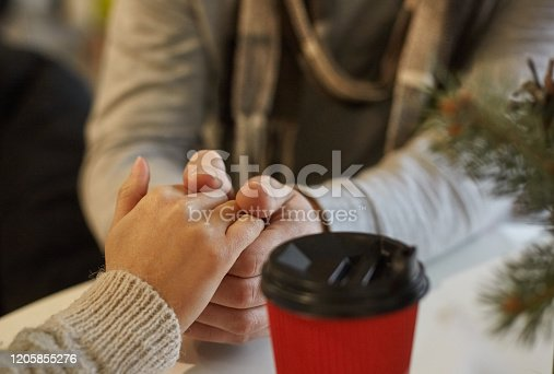 male hands holding female concept around Valentine's Day