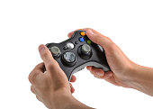 istock Male Hands Holding Gamepad isolated 532125990