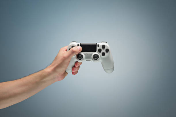 Male Hands Holding Gamepad Male Hands Holding Gamepad at studio gamepad stock pictures, royalty-free photos & images