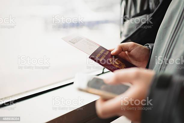 Male hands holding passport ticket for plane and smart phone picture id488906034?b=1&k=6&m=488906034&s=612x612&h=ueu7gtkuy655juyipsmfwvbjxqg02myd3c csanqb5s=