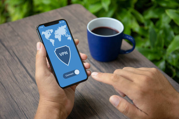 Male hands holding phone with app vpn creation Internet protocols Male hands holding phone with app vpn creation Internet protocols for protection private network vpn stock pictures, royalty-free photos & images