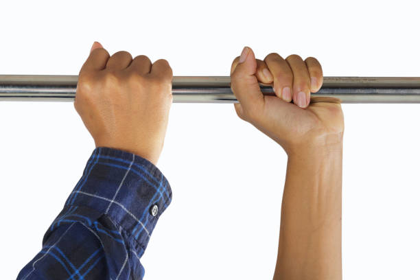 male hands in horizontal bar stock photo